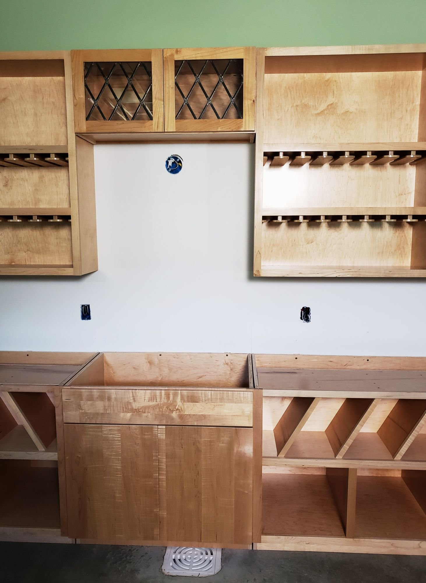 Custom Cabinets Forged Of Wood And Stone