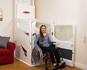 Image of a woman in a wheelchair leaving a vertical lift without a shaft