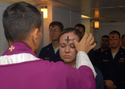 Priest applying ashes