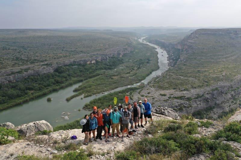 Group Photo with Cretaceous Carbonates at the Pecos River