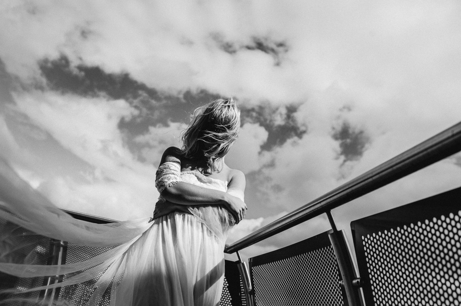 Bride on a windy rooftop