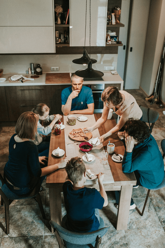 A family sharing a meal at the kitchen table