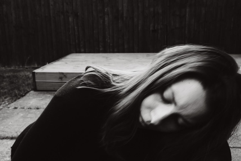 A closeup of a woman.