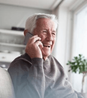 senior-man-telephoning-with-smart-phone-at-home