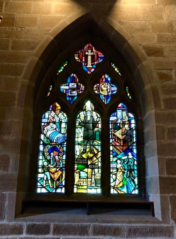Stained glass window in Eyam church