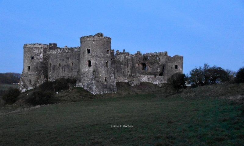 Carew Castle in Pembrokeshire in blue light.