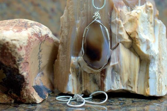 translucent gemstone with silver wire wrapping