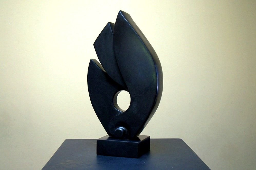 black stone abstract sculpture on square base