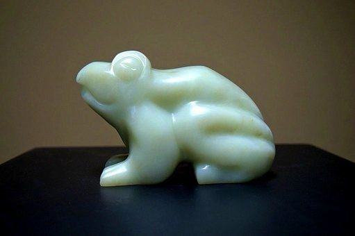 green soapstone carving of a sitting frog