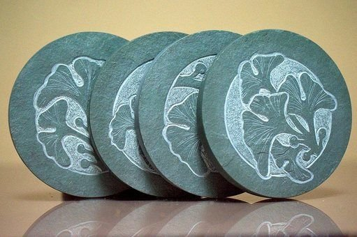 four green carved stone standing on edges