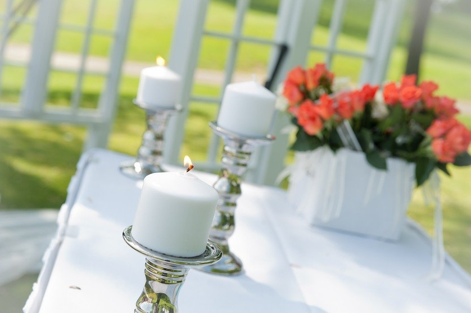 Table set with wedding ceremony candles.