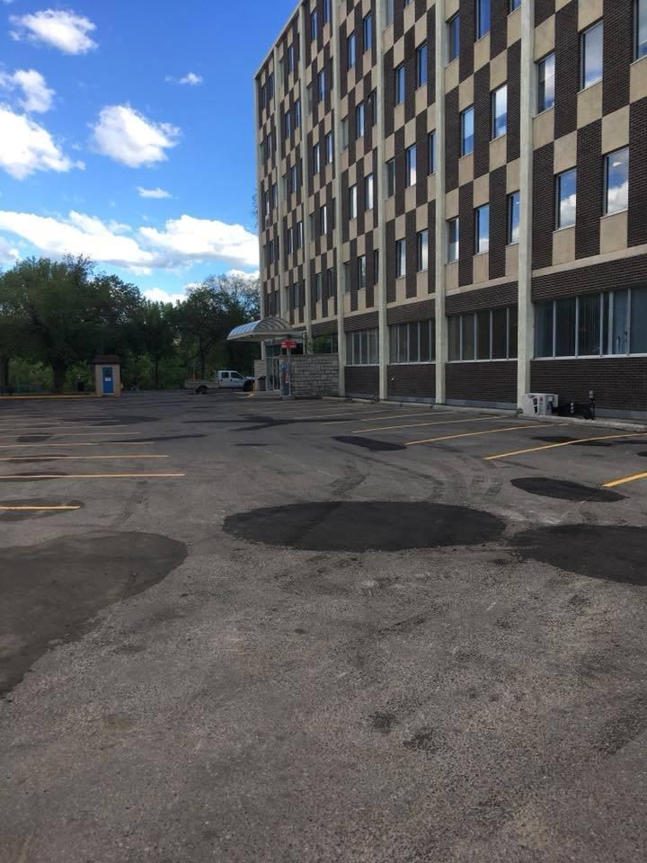 Parkinglot asphalt Patching, paving, slurry seal, crack seal, sweeping & line painting.