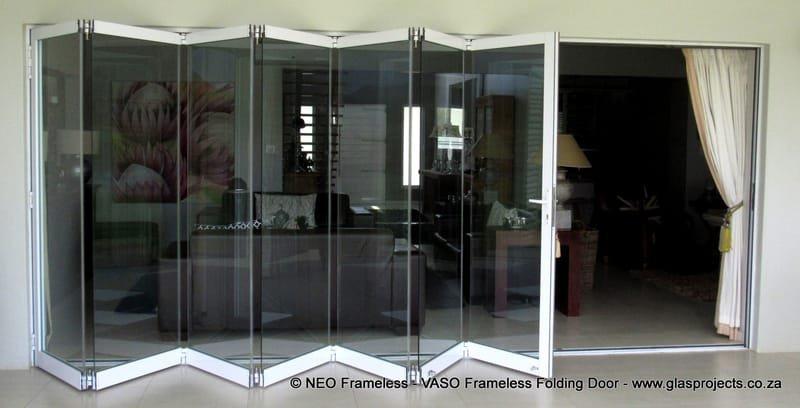 FRAMELESS STACKING DOOR