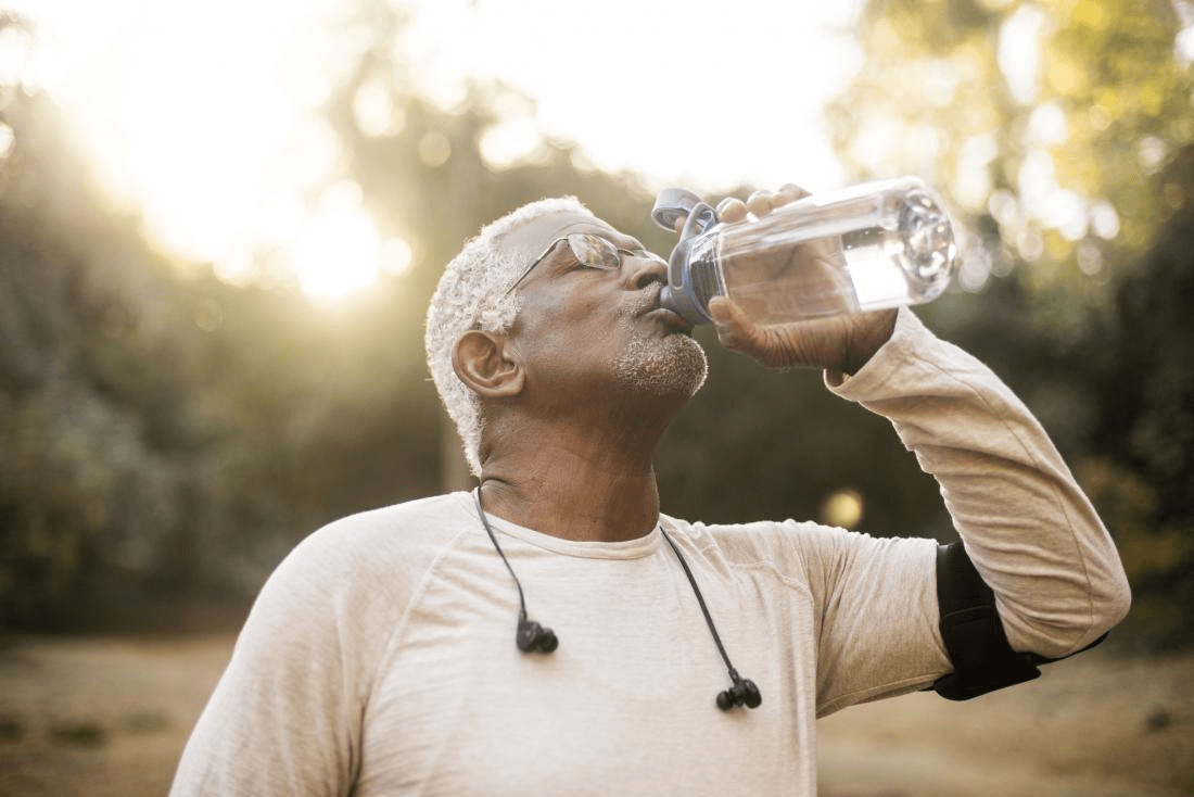 senior male drinking water