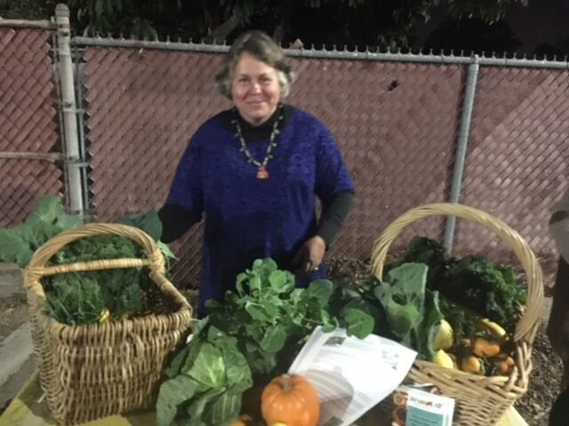 Woman displaying her produce