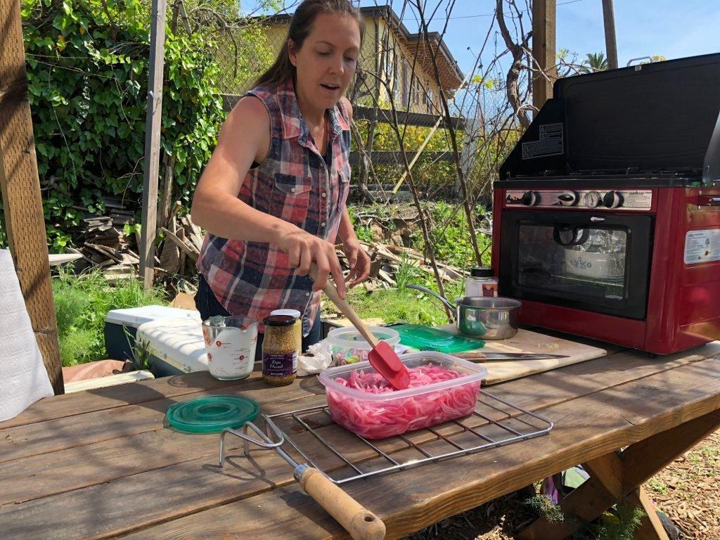 Amanda Aiton making pickled onions.