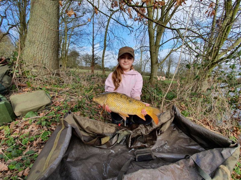 Sophia with a Carp from Pond House