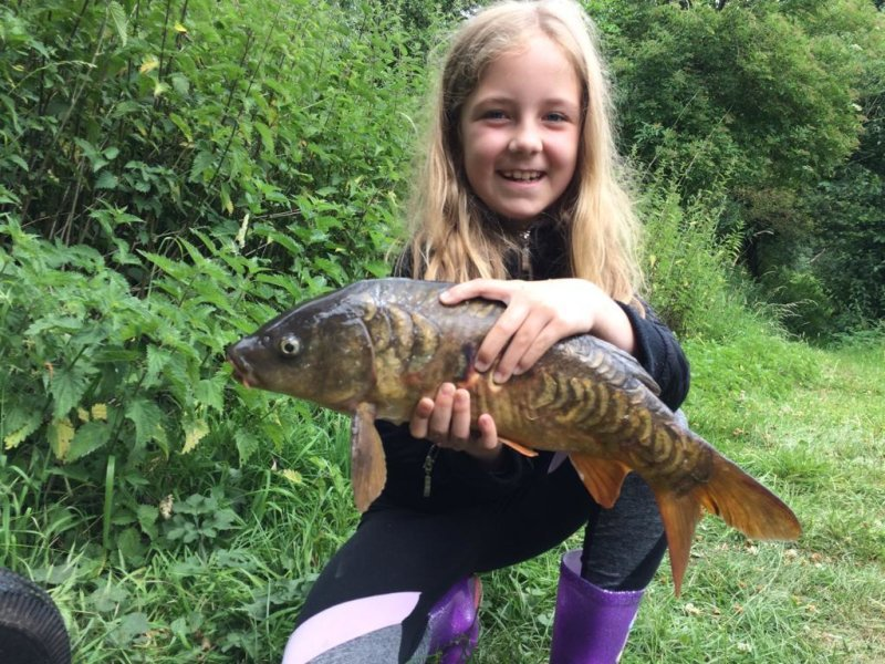 Kaylee with her Mirror Carp from Pond House