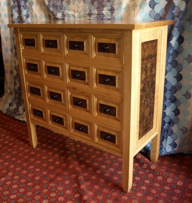oak and black walnut burr veneered cabinet