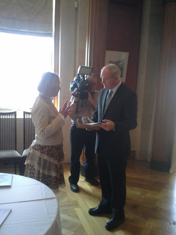 Martin McGuinness, Deputy First Minister and International Statesman, in discussion with Eve Parnell when he officially Opened her solo exhibition in Stormont